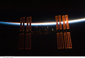 In Earth Orbit - July 28, 2009 -- Backdropped by the blackness of space and the thin line of Earth's atmosphere, the International Space Station is seen from Space Shuttle Endeavour as the two spacecraft begin their relative separation. Earlier the STS-127 and Expedition 20 crews concluded 11 days of cooperative work onboard the shuttle and station. Undocking of the two spacecraft occurred at 12:26 p.m. (CDT) on July 28, 2009..Credit:  NASA via CNP