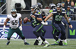 Seattle Seahawks quarterback Russell Wilson (3) scrambles against the Philadelphia Eagles at CenturyLink Field in Seattle, Washington on November 20, 2016.  Seahawks beat the Eagles 26-15.  ©2016. Jim Bryant Photo. All Rights Reserved.
