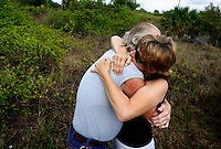"PORT CHARLOTTE, FL -- March 12, 2008 -- Becky Hall hugs Vietnam veteran Thomas ""Wolf"" McCarthy at the site where the body of her son, former Marine Eric Hall, was found in Port Charlotte, Fla., on Wednesday, March 12, 2008.  McCarthy was one of several veteran searches who worked closely with the family to find his body when authority efforts stopped.  Hall went missing on Feb. 3 after having a flashback to his time in Iraq, and was found dead weeks later by Vietnam veteran volunteers in a culvert."