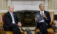 United States President Barack Obama speaks as US Vice President Joe Biden looks on while discussing the release of the Cancer Moonshot Report in the Oval Office of the White House on October 17, 2016 in Washington, DC. <br /> Credit: Olivier Douliery / Pool via CNP /MediaPunch