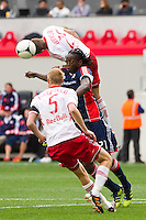 Brandon Barklage (25) of the New York Red Bulls goes over Shalrie Joseph (21) of the New England Revolution on a header. The New York Red Bulls defeated the New England Revolution 1-0 during a Major League Soccer (MLS) match at Red Bull Arena in Harrison, NJ, on April 28, 2012.