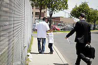 Newark, USA. 07th May 2014. Justin Ayala walks whit his grandphather and a attorney while they arrive to a meeting asking for end to deportations of his father, outside a detention center oficce in New Jersey. Kena Betancur/VIEWpress