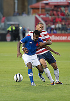 03 June 2012: US Men's National Soccer Team midfielder Jermaine Jones  #13 and Canadian Men's National Soccer Team midfielder Julian de Guzman #6 in action during an international friendly  match between the United States Men's National Soccer Team and the Canadian Men's National Soccer Team at BMO Field in Toronto..The game ended in 0-0 draw..