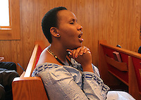 Emmy Gitugu sings along from the pews during Sunday service at The Africa Lighthouse Baptist Temple near Stony Point in Albemarle County, VA. The small 10 family congregation is made up of African refugees and immigrants who's service is spoken in Swahili and translated into English. They've just signed a rent-own lease for a small church after meeting for three years at a local school. Photo/The Daily Progress/Andrew Shurtleff