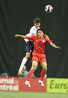 Nathan Sturgis heads the ball over Young Sung Shim. Republic of Korea met USA in the second game of a doubleheader at the Olympic stadium, Montreal, Canada on June 30 2007, in the opening game of the FIFA U20 World. The game ended in a 1-1 tie.