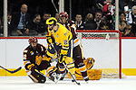 09 APR 2011: University of Minnesota Duluth forward Mike Connolly (22) blocks a shot in front of his team's net while Jeff Rohrkemper (22) of the University of Michigan moves in to shoot in the second period during the Division I Men's Ice Hockey Championship held at the Xcel Energy Center in St. Paul, MN. Minnesota-Duluth beat Michigan in overtime, 3-2 to claim the national title. Vince Muzik/ NCAA Photos