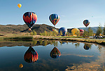 Hot air balloons float over pond, Snowmass Balloon Festival, Colorado Sept. 18-20, 2009
