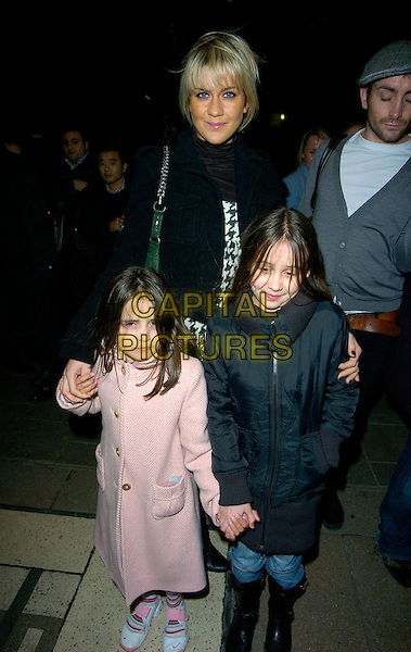 """KATE LAWLER. At the """"Wicked"""" Gala Performance & Cast Change,.Appolo Theatre, London, England, 9th January 2007..full length black and white houndstooth print dress tights jacket  with litle girl guests pink.CAP/CAN.©Can Nguyen/Capital Pictures"""