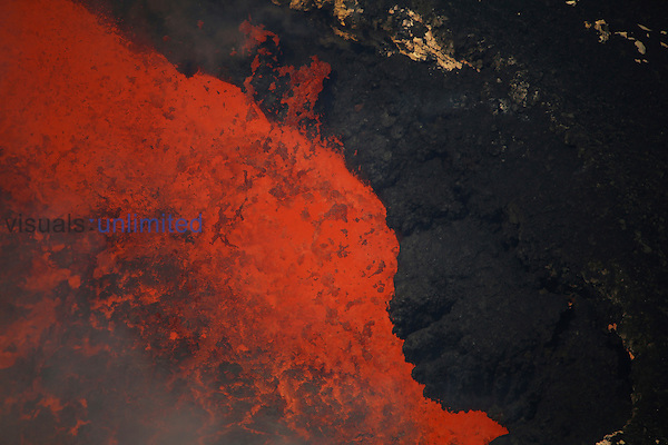 Lava lake with small bursting lava bubble in bottom of Santiago Crater of erupting Masaya Volcano, Nicaragua