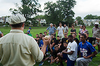"Scott Alberts, president of the Athletic Base Ball Club of Philadelphia, explains ""orange peel"" style ball to the players from the Mt. Airy Stars and the Potter Pirates."