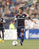 New England Revolution midfielder Lee Nguyen (24) brings the ball forward. In a Major League Soccer (MLS) match, Montreal Impact defeated the New England Revolution, 1-0, at Gillette Stadium on August 12, 2012.