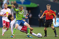 Seattle Sounders FC midfielder Osvaldo Alonso  and New York Red Bulls midfielder Mehdi Ballouchy collide during play at Qwest Field in Seattle Saturday June 23, 2011. The Sounders won the game 4-2.