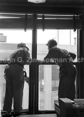 Window washers at work on Atlanta high-rise building, Atlanta, Georgia, 1952. Credit: © John G. Zimmerman Archive