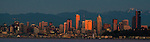 Sun light reflects off the Seattle skyline. Photo was taken from  Manchester Bay near the Kitsap Peninsula on February 17, 2015. © 2015. Jim Bryant Photo. ALL RIGHTS RESERVED.