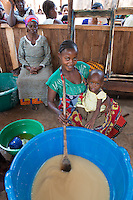 Africa, DRC, Democratic Republic of the Congo, South Kivu, Kamanyola. Women for Women project. WFW co-op and lifeskills training. Women mixing ingredients to make medicinal soap for sale. Penousi Bahati, women mixing ingredients to make medicinal soap for sale.