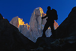 Hiker silhouetted against Monte Fitz Roy, Argentina