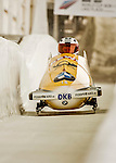 8 January 2016: Maximilian Arndt, piloting his 2-man bobsled for Germany, enters the Chicane straightaway on his first run, ending the day with a combined 2-run time of 1:51.43 and earning a 6th place finish at the BMW IBSF World Cup Championships at the Olympic Sports Track in Lake Placid, New York, USA. Mandatory Credit: Ed Wolfstein Photo *** RAW (NEF) Image File Available ***