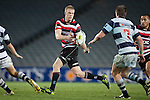 Baden Kerr flicks the ball back inside to Tyrone Lefau as he runs across field. ITM Cup Round 7 rugby game between Auckland and Counties Manukau, played at Eden Park, Auckland on Thursday August 11th..Auckland won 25 - 22.