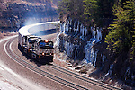A Norfolk Southern Roadrailer<br /> &reg; train made up of truck trailers on single rail bogies glides north over the &quot;Rathole&quot; line in southern Kentucky.