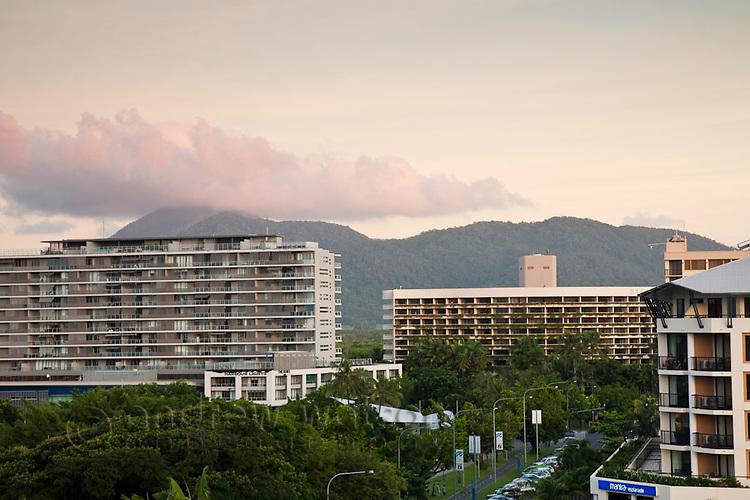 City skyline including Harbour Lights and Hilton Hotel at dusk.  Cairns, Queensland, Australia