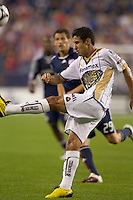 Pumas UNAM defender Luis Fuentes (33) clears the ball. The New England Revolution defeated Pumas UNAM in SuperLiga group play, 1-0, at Gillette Stadium on July 14, 2010.