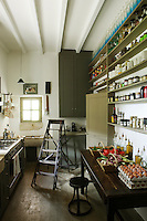 The original kitchen is also used as a larder and is fitted out to resemble an old village shop
