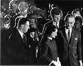 """Arlington, VA - (FILE) -- United States President Lyndon B. Johnson, far right, and first lady Lady Bird Johnson lead United States Senator Edward M. """"Ted"""" Kennedy (Democrat of Massachusetts), Mrs. Robert F. (Ethel) Kennedy, and Kennedy family and friends from the gravesite at the conclusion of funeral services for the late U.S. Senator Robert F. Kennedy on June 9, 1968..Credit: Arnie Sachs / CNP"""