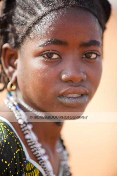 Portrait of a young Fulani woman in the town of Djibo in northern Burkina Faso, West Africa.