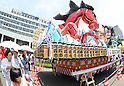 July 16th, 2011, Sendai, Japan - Japanese people walk past the Nebuta festival's float at the Tohoku Rokkon Festival, July 16, 2011, in Sendai city, Miyagi prefecture, northeastern Japan, about 90km away from the tsunami-crippled Fukushima Daiichi Nuclear Power Plant. The six major festivals in the Tohoku region, comprising Sansa Odori in Iwate, Nebuta Matsuri in Aomori, Tanabata Matsuri in Sendai, Hanagasa Matsuri in Yamagata, Kanto Matsuri in Akita, and Waraji Matsuri in Fukushima, are performed together at Tohoku Rokkon Festival for the first time to overcome the many harmful rumors and atmosphere of excessive restraint, to recover the visiting population in order to revive the regional economy, and accomplish reconstruction after the March 11's earthquake and tsunami. (Photo by Tomoyuki Kaya/AFLO) [3694]