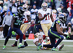 Seattle Seahawks  linebacker K.J. Wright  (50) gets up after sacking San Francisco 49ers quarterback Colin Kaepernick (7) at CenturyLink Field in Seattle, Washington on December 14, 2014.  Kapernick was sacked six times in the Seahawks 17-7 win  over the 49ers  © 2014. Jim Bryant Photo. All Rights Reserved.