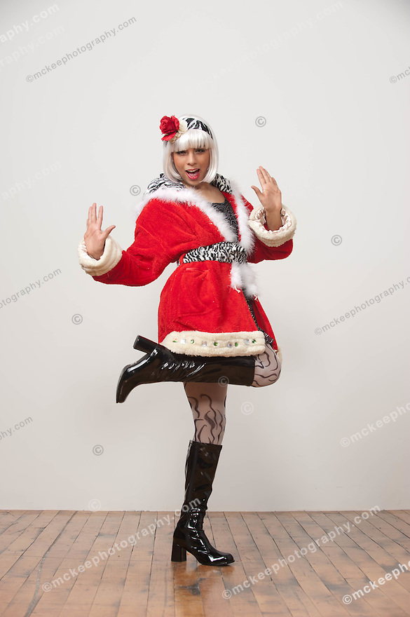 White wig and red santa claus jacket dancing on white background