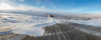 Panorama of snow drifting on the James Dalton highway, Brooks range, Arctic, Alaska.