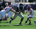 Ole Miss running back Brandon Bolden (34) is tackled by Jacksonville State defensive end Jamison Wadley (93) and Jacksonville State outside linebacker Nick Johnson (24) at Vaught-Hemingway Stadium in Oxford, Miss. on Saturday, September 4, 2010.