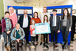 """Martin Carey at the launch of his new book of cartoons entitled """"The Hahah"""" in the Killarney's Library last Saturday. Pictured with l-r Breda Hughes, cllr Michael Gleeson, Mary Hughes, Danny Healy Rae TD, Holly, Tina and Hazel Carey, Michael Healy Rae TD and cllr Maura Healy Rae."""