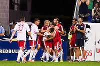 Heath Pearce (3) of the New York Red Bulls celebrates scoring with teammates . The New York Red Bulls  defeated the Portland Timbers 3-2 during a Major League Soccer (MLS) match at Red Bull Arena in Harrison, NJ, on August 19, 2012.