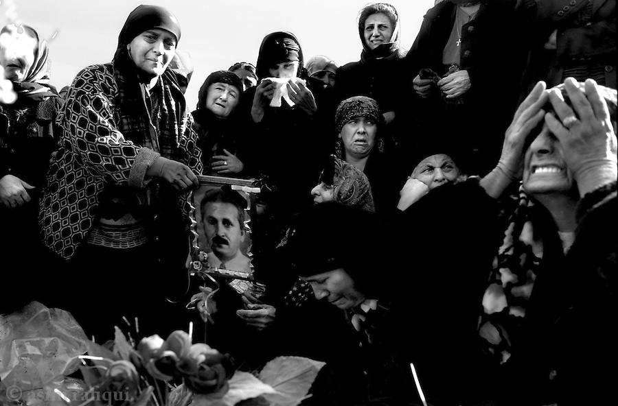 gandakosa village, northern iraq,january 2005: mourners at the funeral of isaac sheba slewa who was killed by iraqi insurgents/resistance fighters while on his way to mosul.  the christians are considered 'natural' allies of the US occupation forces and have been increasingly targeted by the insurgents/resistance fighters.  they are also being targeted to clens entire cities like mosul, baghdad and kirkuk of their presence prior to the upcoming elections<br />
