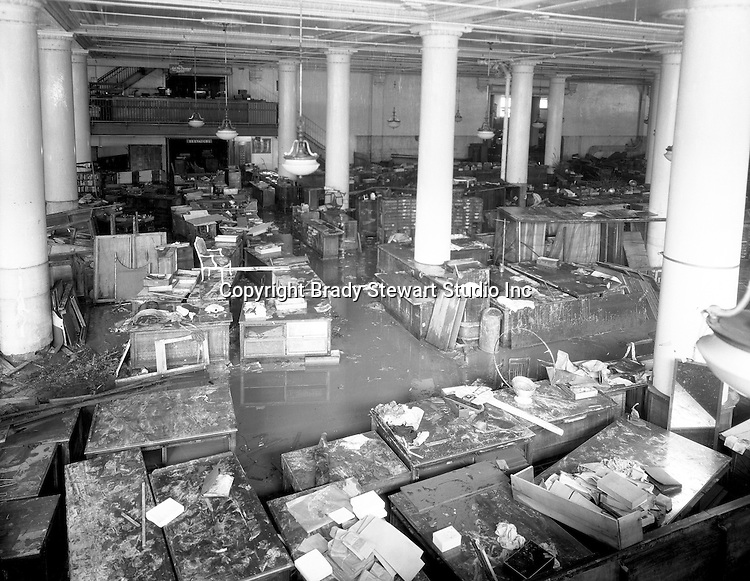 Pittsburgh PA: View of the basement of the Joseph Horne Company Store after the flood - 1936.  On March 16, 1936, warmer-than-normal temperatures led to the melting of snow and ice on the upper Allegheny and Monongahela rivers. Heavy rains overnight caused the waters to rise quickly and the water peaked at about 46 feet, 21 feet above flood stage.