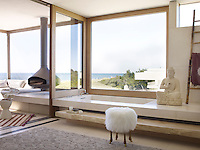 In Behun's bathroom, the tub is French limestone, the stool is by Marc Bankowsky, and the rug is by ABC Carpet & Home