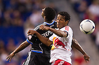 Khari Stephenson (7) of the San Jose Earthquakes goes up for a header with Roy Miller (7) of the New York Red Bulls during a Major League Soccer (MLS) match at Red Bull Arena in Harrison, NJ, on April 14, 2012.