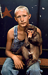 00666_10, Deep Ancestry, 07/05, Russian Circus Performer, UZBEKISTAN-10005NF. A boy sits with his pet monkey.<br />
