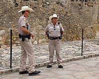 Alamo police officers complete with their Texas trademark hats. Shot along one of the Alamo's old mission walls..