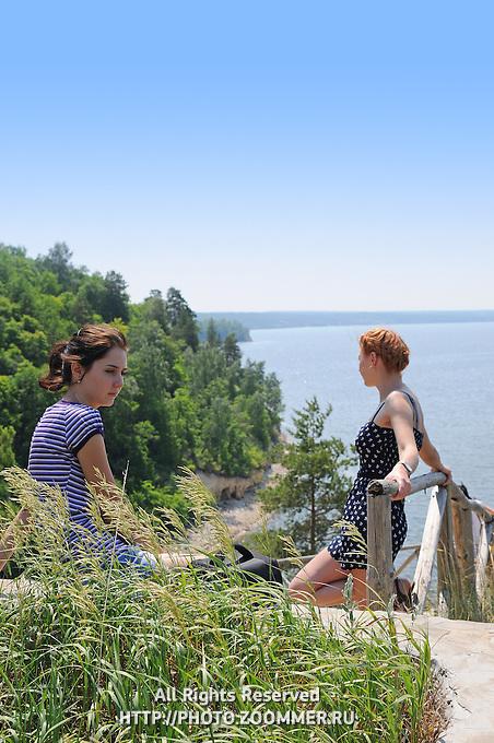 "Sad girls near the drop-and-check descent to Zhiguli reservoir in Russian National Park ""Samarskaya Luka"""