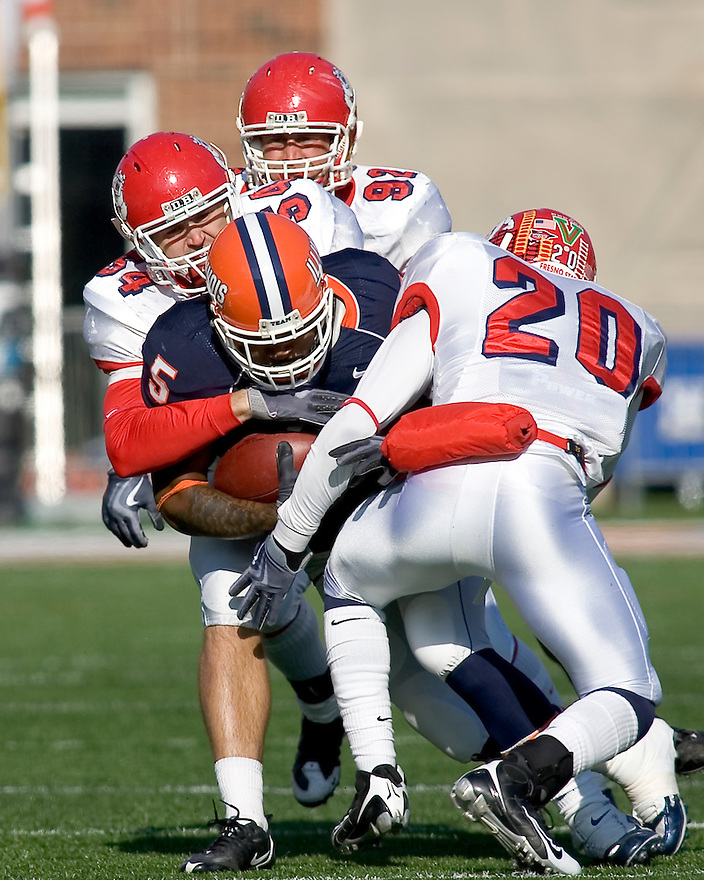 December 5, 2009 - Champaign, Illinois, USA -  Fresno State linebacker Ben Jacobs (54) tackles Illinois running back Mikel Leshoure (5) in the game between the University of Illinois and Fresno State at Memorial Stadium in Champaign, Illinois.  Fresno State defeated Illinois 53 to 52.