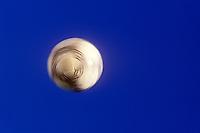 Soccer ball spins in flight.
