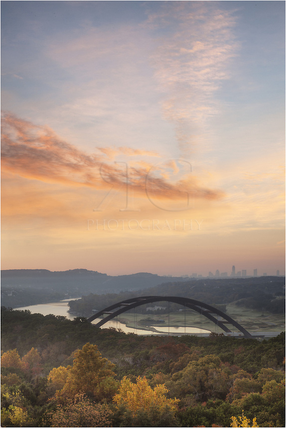 November morning in Austin, Texas. This picture of Austin is from just beyond the Pennybacker Bridge and looks back towards downtown. The Austin skyline awoke in a layer of light fog on this cool morning.
