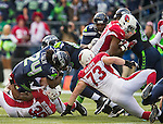 Seattle Seahawks running back Marshawn Lynch (24) is brought down by Arizona Cardinals cornerback Antonio Cromartie (31)after a short gain at CenturyLink Field in Seattle, Washington on November 23, 2014. The Seahawks beat the Cardinals 19-3.  ©2014. Jim Bryant Photo. All Rights Reserved.