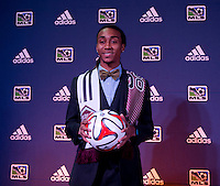 #12 overall pick Marlon Hairston of the Colorado Rapids stands on the podium during the MLS SuperDraft at the Pennsylvania Convention Center in Philadelphia, PA, on January 16, 2014.