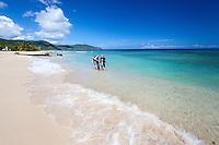 Tracey Gardner and Rodrigo Fass MR.Preparing for a beach dive.Cane Bay, St. Croix.U.S. Virgin Islands