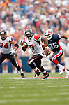 25 September 2005: Michael Vick (7), Quarterback for the Atlanta Falcons, scrambles for first down yardage in a game against the Buffalo Bills. The Falcons defeated the Bills 24-16 at Ralph Wilson Stadium in Orchard Park, NY.<br /><br />Mandatory Photo Credit: Ed Wolfstein.