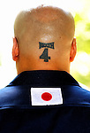 "Shinichi Kamijo, founder of ultra-rightwing group Gishin Gokoku-kai, shows off his tatoo -- the number 4 (""shi"" in Japanese and a homonym that also means ""death"") and DEATH -- as he waits to offer prayer at Yasukuni Shrine in Tokyo on Saturday 15 Aug. 2009. Aug. 15 marks the 64th anniversary of Japan's surrender in the Pacific War."